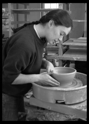 Sarah House at the pottery wheel SKH pottery